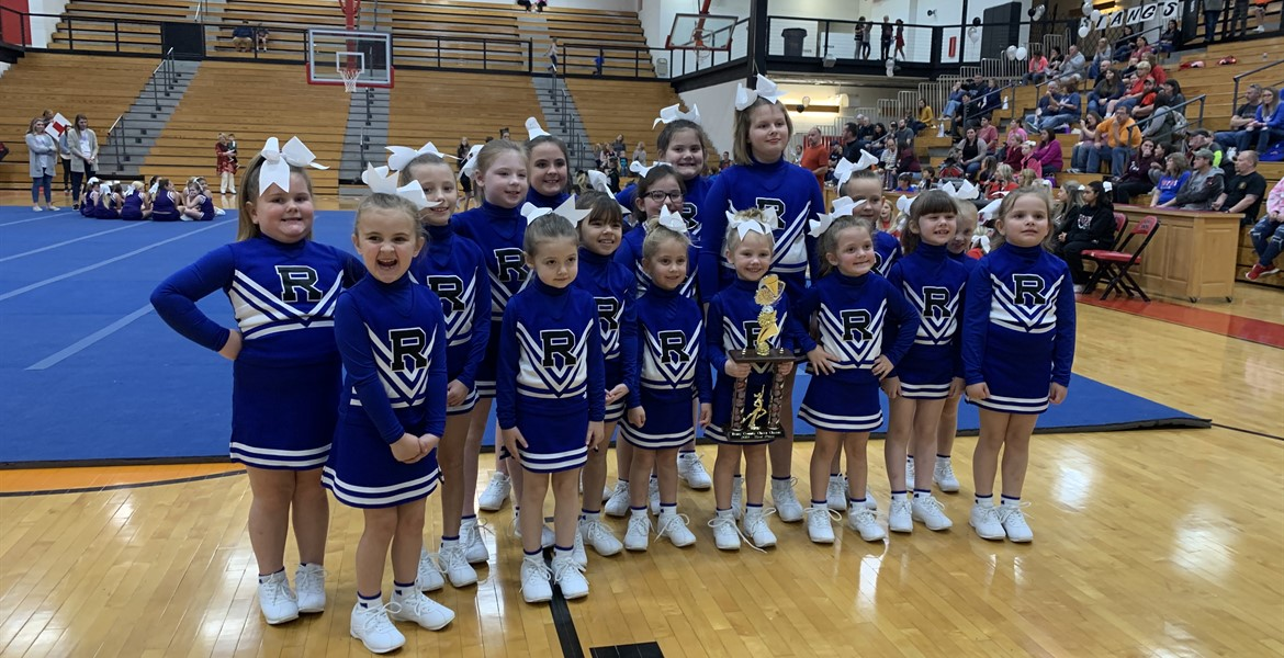 Our cheer team with their 1st place trophy!