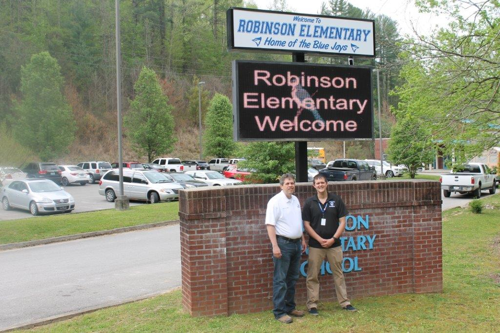 Mr. Fugate and Scott Alexander in front of our new sign!