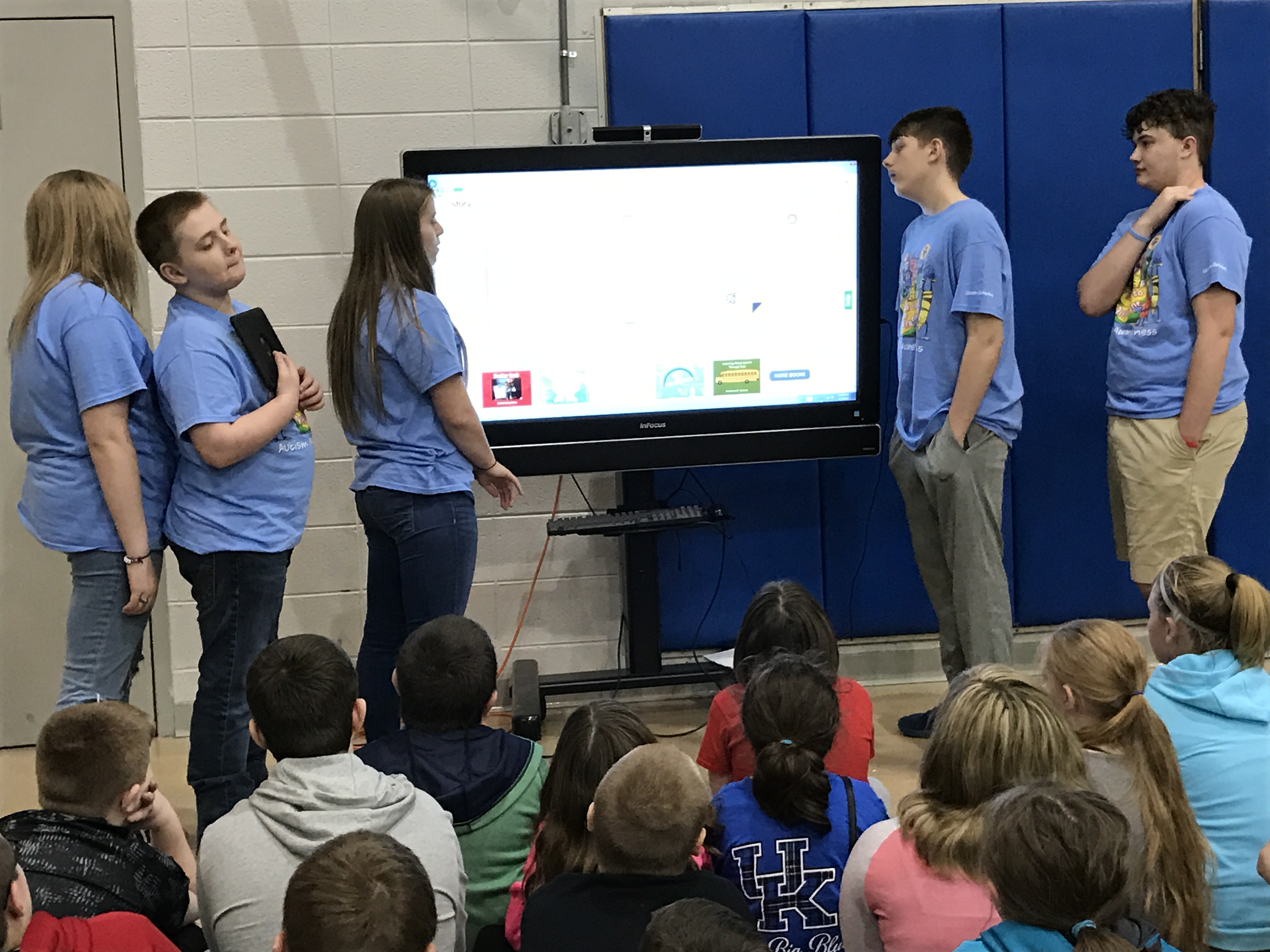 The STLP team is presenting Kelby's book to all grades on Autism Awareness Day!