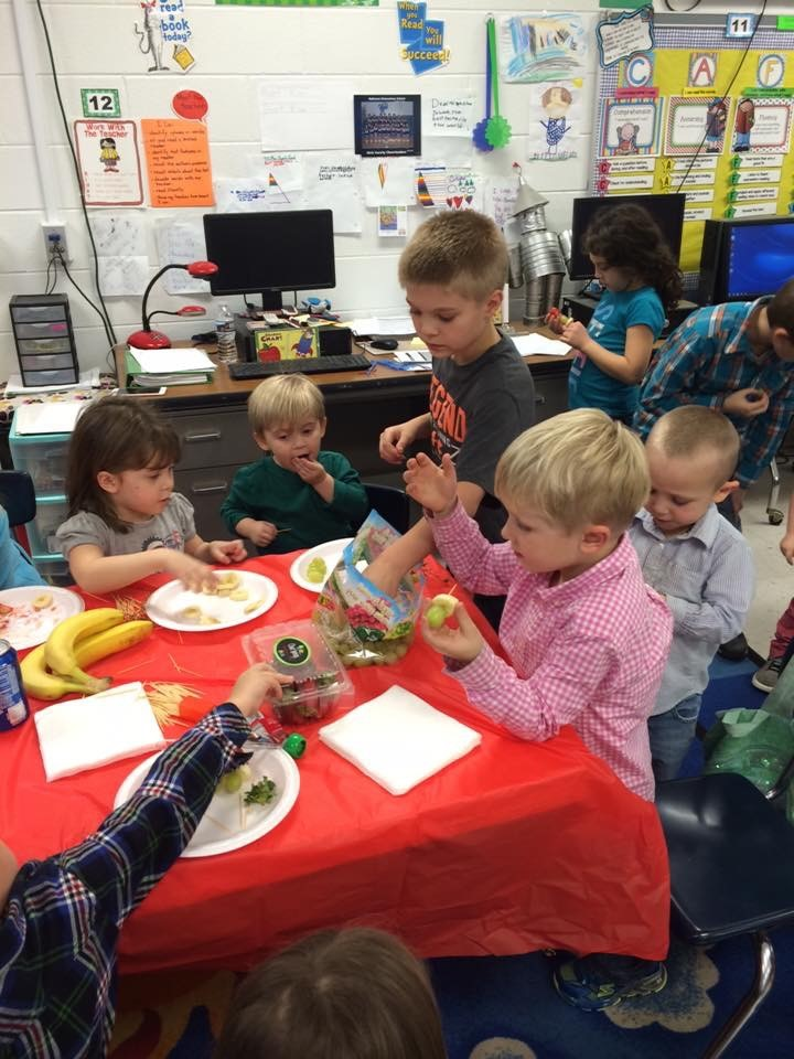 Making a grinchy snack during the Born Academy.