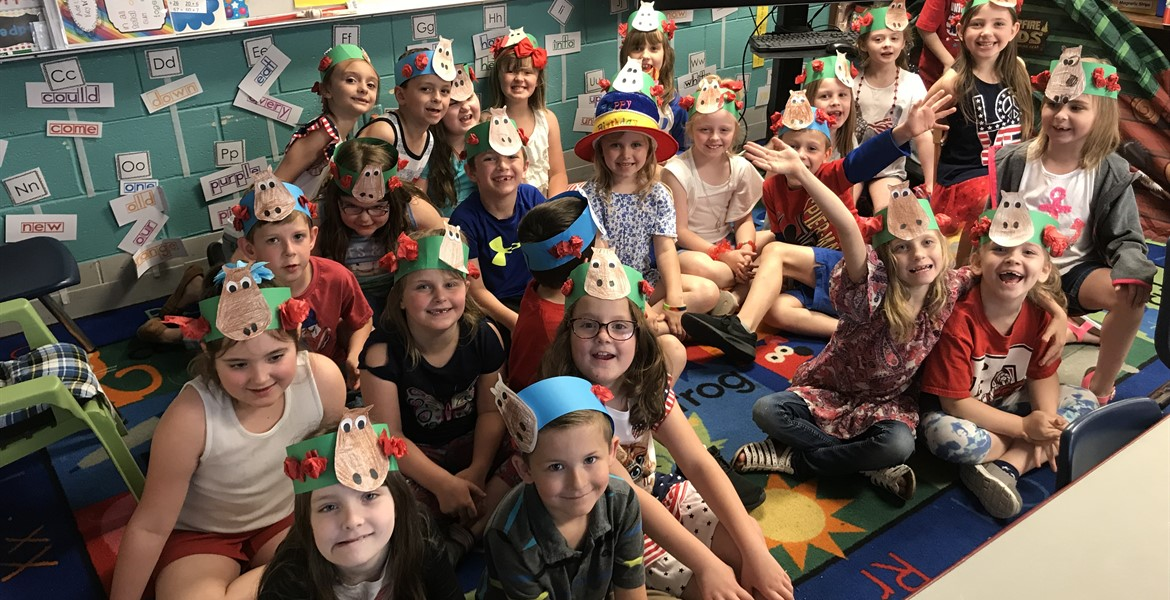 Mrs. Vanover's First Grade made horse hats with rose garlands in celebration of Derby Day.