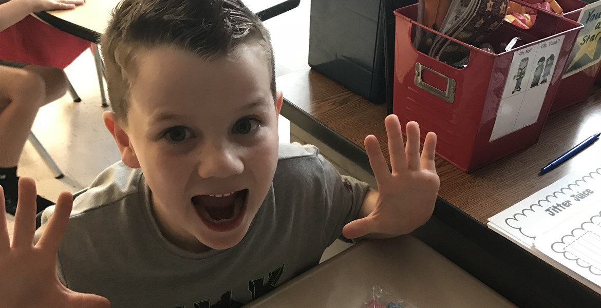 The excitement of a new school year is written all over his face!