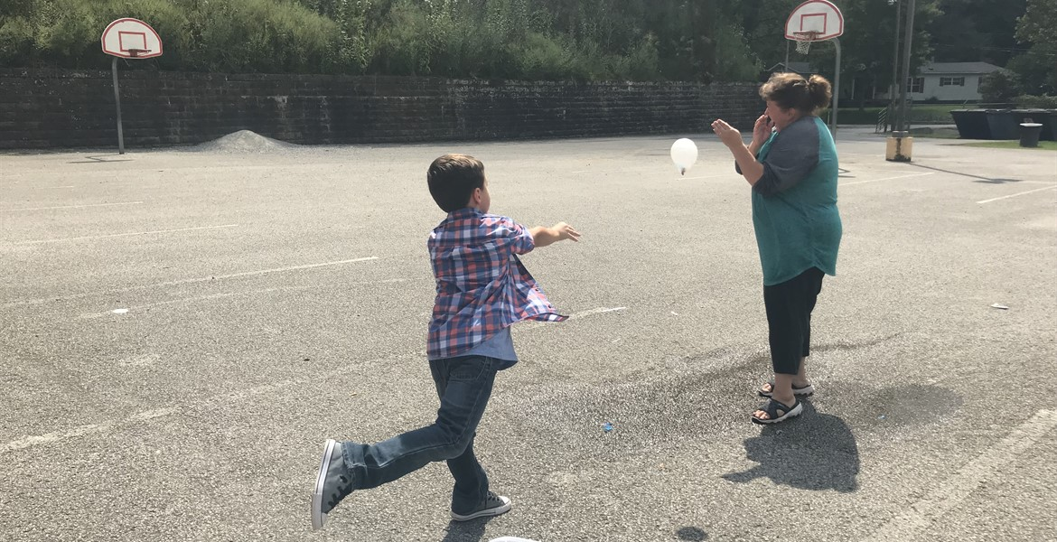 Students get to hit Mrs. Hamblin with water balloons.